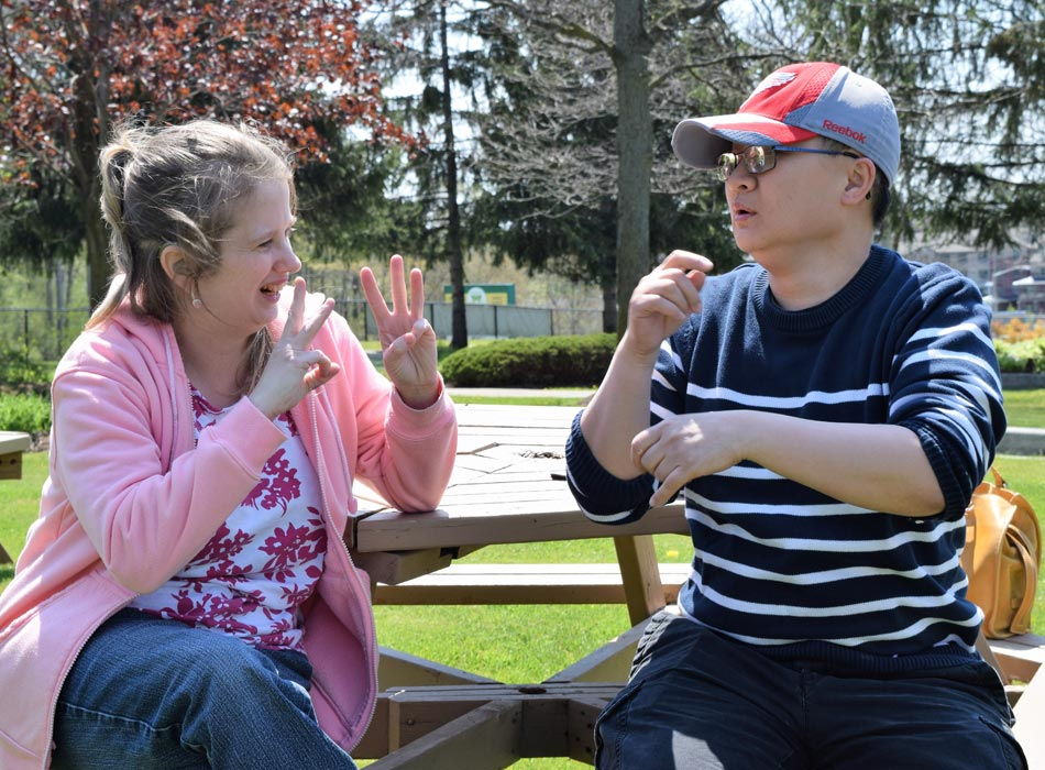 deafblind people communicating with sign language